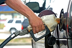 Pumping fuel Stock Images