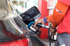 Pumping gas into a car Royalty Free Stock Photo