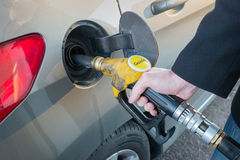 Pumping gas. Close up of man pumping fuel Stock Photography