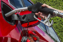 Pumping Gas - Filling a car with fuel stock photography
