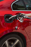 Filling a car with fuel - Pumping Gas Stock Photo