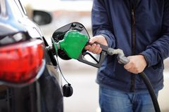 Pumping gas at gas pump Royalty Free Stock Photo