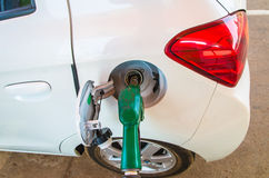 Pumping gas at gas pump Stock Images
