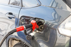 Pumping gas at  pump. Closeup of man  gasoline fuel in car   station. Stock Photos