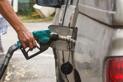 Pumping gas in to the tank Royalty Free Stock Images
