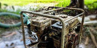 Pumping machine to drain water into the fields royalty free stock photos