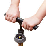 Pumping by manual air pump with pressure indicator Royalty Free Stock Image