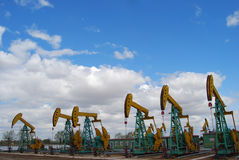 Pumping oil. Multitudinous pumping are working in oilfield Stock Photo