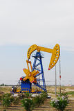 Pumping oil. Dual horse head pumping unit Royalty Free Stock Photo