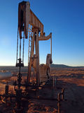 Pumping Oil. Pumping hydrocarbons at a desert well on a winter afternoon Royalty Free Stock Photos