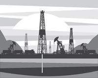 Production of oil from a well drilled in the ground. Pumping oil out of a borehole drilled in the ground Stock Photo