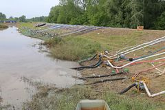 Levee Floods. Pumping Out Flood Water at Levee Embankment stock images