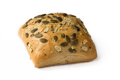 Pumping seed wholemeal bun isolated on white. Royalty Free Stock Photo