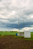 Pumping station for pumping oil on a background of cumulus clouds Stock Photo