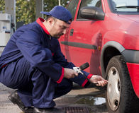 Pumping Tyre. Mechanic Checking Tyre Pressure at Gas Station Stock Photography