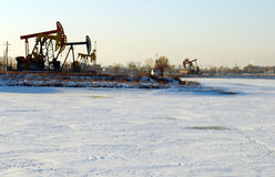 Pumping unit. In snow ground of take out the pumping unit Royalty Free Stock Images