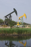 Pumping unit. Image of pumping jacks in production in the wetland Stock Photography