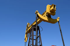 Pumping unit as the oil pump installed on a well Royalty Free Stock Images