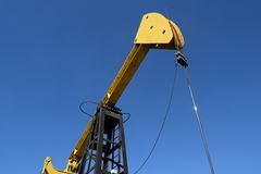 Pumping unit as the oil pump installed on a well Royalty Free Stock Photo