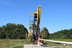 Pumping unit as the oil pump installed on a well Stock Photography