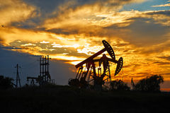 Pumping unit sunset Stock Image