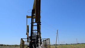 The pumping unit on a well stock footage