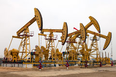 Pumping units. Are gethering oil in the field Stock Image
