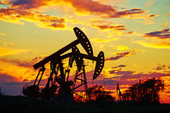 Pumping units in sunset glow Stock Photos