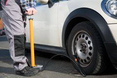 Pumping up a flat tire Royalty Free Stock Images