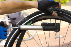 Pumping up repaired bike tyre II Royalty Free Stock Photos