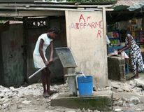 Pumping water in Cap Haitien. Stock Photo