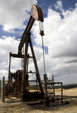 Pumpjack. A landscape domined by a Oil rig in Burgos, Spain Stock Images
