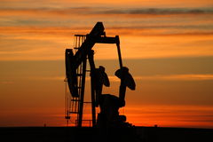 Pumpjack at dawn. A pumnpjack in the early morning in Williston North Dakota Stock Photography