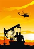 Pumpjack ed elicottero Fotografia Stock