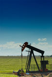 Pumpjack in field Stock Photo