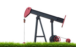 Pumpjack with green grass Stock Image