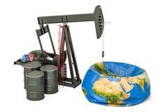 Pumpjack met olievaten en gelaten leeglopen Aardebol, olieproductie royalty-vrije stock foto's