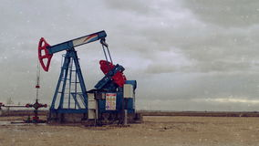 Pumpjack Oil Pump operating on natural gas in the field pumping from the oil well stock video footage