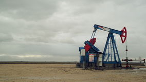 Pumpjack Oil Pump operating on natural gas in the field pumping from the oil well stock video