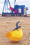 Pumpjack Oil Pump And Protective Helmet Stock Photography