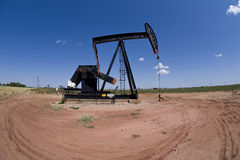 Pumpjack over oil well Stock Image