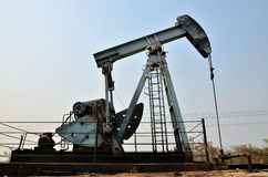 Pumpjack pumping crude oil from oil well Royalty Free Stock Photo