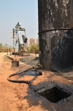 Pumpjack pumping crude oil from oil well Stock Image