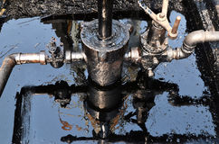 Pumpjack pumping crude oil from oil well Royalty Free Stock Photography