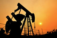 Pumpjack pumping crude oil from oil well Stock Photo