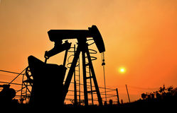 Pumpjack pumping crude oil from oil well Royalty Free Stock Photos