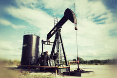 Pumpjack pumping crude oil Royalty Free Stock Photo
