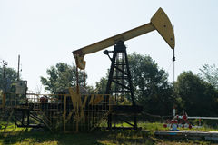 Pumpjack pumps oil outdoors Stock Image