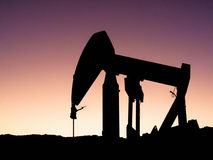 Pumpjack Silhouette. An old pumpjack silhouetted against the twilight sky Royalty Free Stock Photos