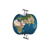 Pumpjack sucking the earth Royalty Free Stock Photos